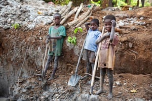 Seven-year-olds Zehowa Andre, Nguewo Gambert and Ngbaza Martin work on a gold-mining site near Baboua, Central African Republic