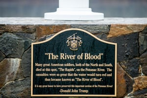 """""""A plaque that reads \""""The River of Blood\"""" sits at the base of a flagpole between the 14th and 15th hole at the Trump National Golf Club  in Sterling, Va., Wednesday, Dec. 2, 2015. The historical accuracy that \""""American soldiers, both of the North and South, died at this spot\"""" has been called into question by historians. (AP Photo/Andrew Harnik)"""""""