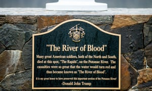 A plaque at the base of a flagpole between the 14th and 15th hole at Trump National in Sterling, Virginia. The battle described never happened.