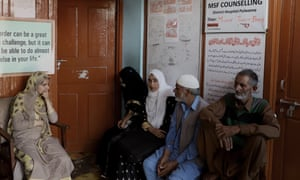 People sit in the waiting room at the Pulwama mental health clinic