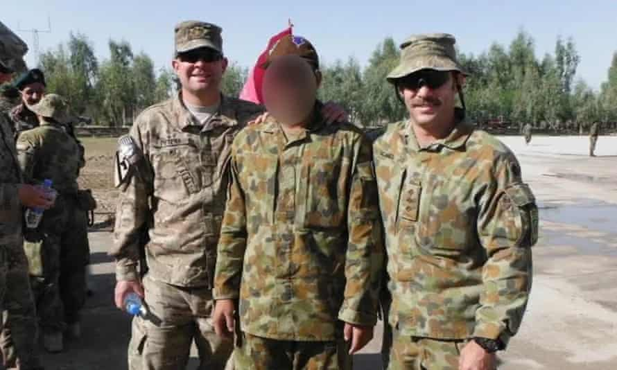 Afghan interpreter Hassan with coalition troops in Afghanistan
