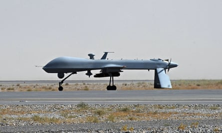 A US Predator unmanned drone armed with a missile stands on the tarmac of Kandahar military airport.