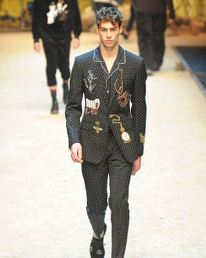 A suit, complete with a bee, on Dolce & Gabbana's menswear catwalk.
