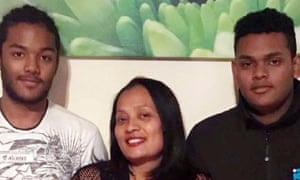 Brothers Sean Rajoobeer, 17, and Shane Rajoobeer, 18, with their mother Mary, three of the five victims of the explosion.