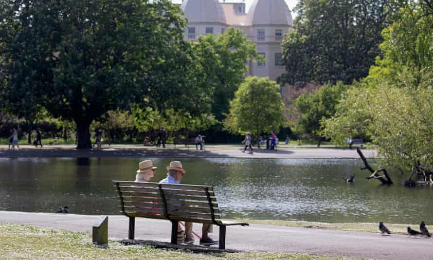 An older couple enjoying Regent's Park, London, in May. For the week ending 17 July excess deaths for England Wales were 3% below the five-year average.
