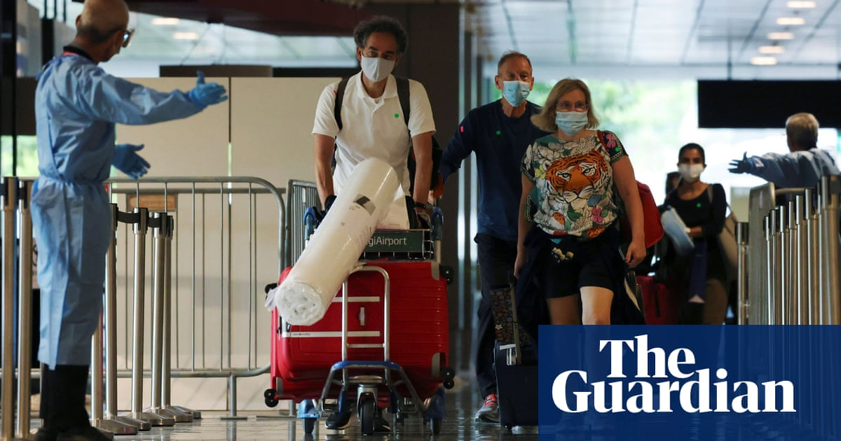 Singapore hospitals risk being 'overwhelmed' after record daily Covid deaths