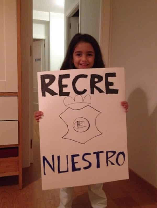 """Narciso's daughter Aurora with her home made """"Recre is ours"""" placard"""