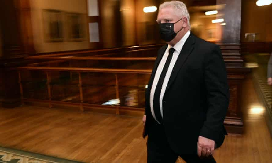 Ontario premier Doug Ford walks to a press conference at Queen's Park, in Toronto, on 16 April.