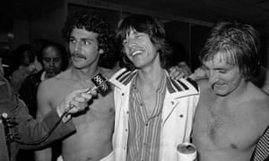 Singing star Mick Jagger, center, visits the Cosmos soccer team locker room in Giants Stadium in New Jersey, June 1, 1977. Steve Hunt, who went on to star for Coventry, is on the right.