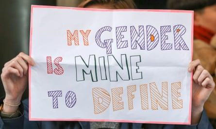 A protest sign saying 'My gender is mine to define'