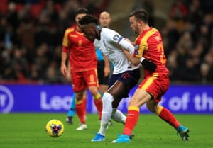 England's Tammy Abraham (left) and Montenegro's Marko Simic fight for the ball.