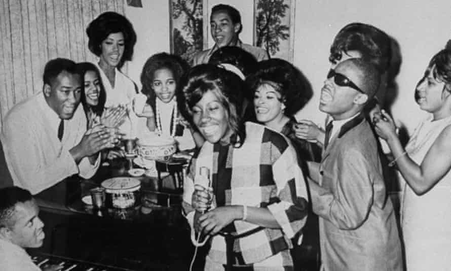 Berry Gordy plays piano as a group including Smokey Robinson and Stevie Wonder join in singing together at Motown Studios