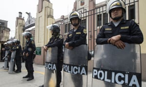 Peruvian police officers stand guard outside a police facility in Lima on Wednesday where Keiko Fujimori was taken after being arrested for alleged money laundering.
