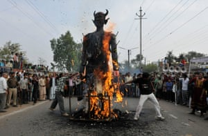 Survivors of the Bhopal gas disaster and activists burn an effigy and hold a protest against Dow Chemical in front of a Union Carbide premises in India.