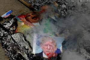 Gaza City, Gaza Strip: Photographs of US president, Donald Trump, Bahrain's King Hamad bin Isa Al Khalifa, and Israeli prime minister, Benjamin Netanyahu, are burned by Palestinians during a protest against the United Arab Emirates and Bahrain's deal with Israel to normalise relations.