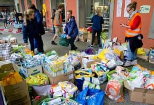 Volunteers sort through items