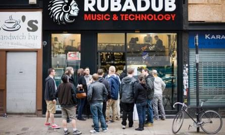 Customers stand outside Rubadub record shop in Glasgow, UK