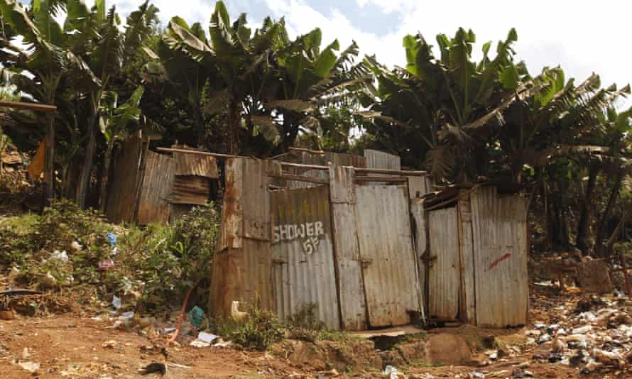A public toilet made of rusty sheets of metal in Kibera slum in Nairobi, Kenya.