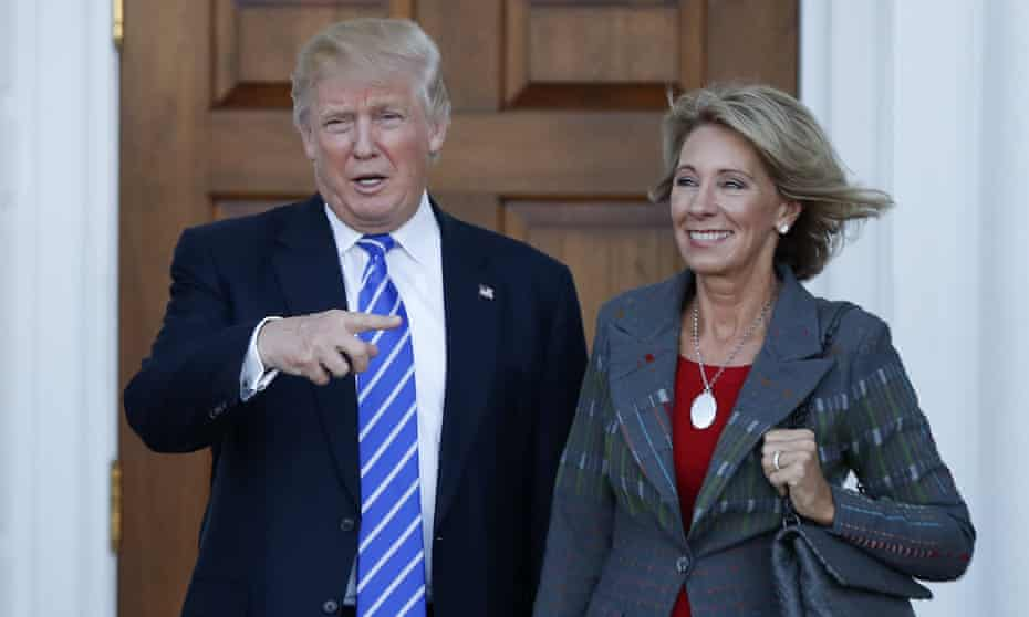 Donald Trump with Betsy DeVos, his pick for education secretary, who faces lawmakers on Tuesday.