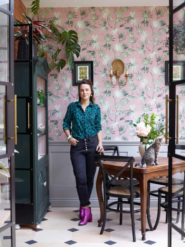 Ruthie Hudson in the garden room, with wallpaper by Pearl Lowe for Woodchip & Magnolia.
