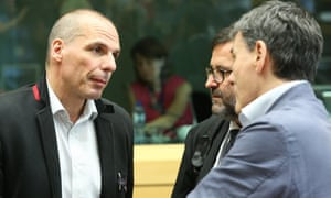 Greece's finance minister Yanis Varoufakis, right, at the debt summit in Brussels.