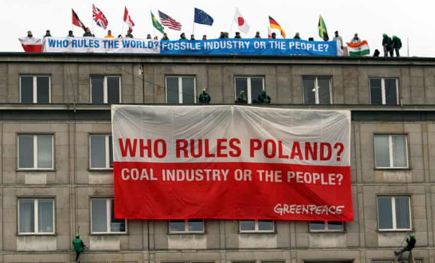 Greenpeace environmentalists protest against the International Coal and Climate Summit in Warsaw