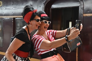 Elvis fans Debirah Petreski and Gail Goulding take a selfie before boarding the Blue Suede Express at Central Station in Sydney