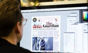 The Guardian newsroom at work on the first edition of the new tabloid format.