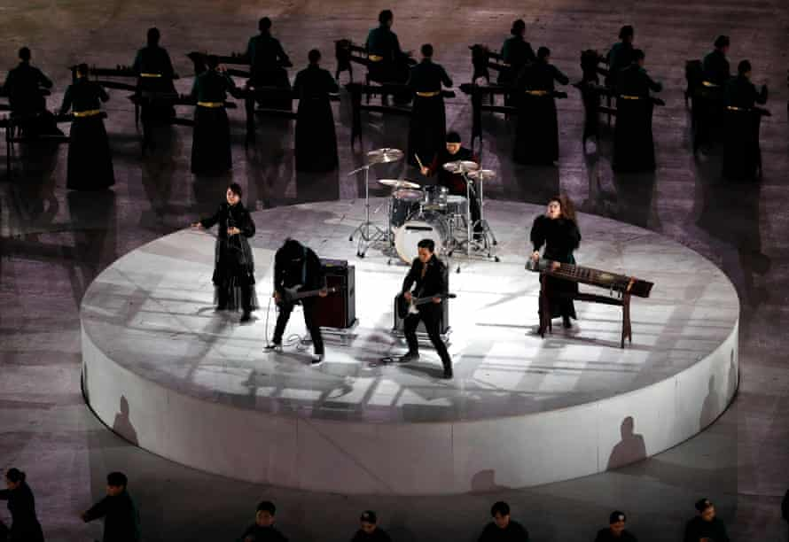 Geomungo players perform together with the band Jambinai