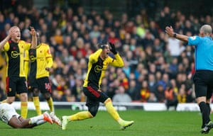 Gerard Deulofeu of Watford holds his head in disbelief after a refereeing decision by Mike Riley.