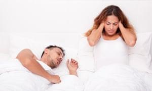 Snoring man, awake woman