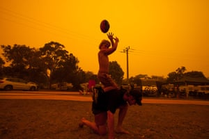Families and children play at the foreshore caravan park moments before evacuating to the main hall.
