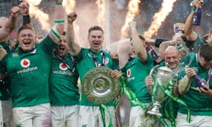 Jonathan Sexton, second left, holds the Triple Crown as Ireland celebrate winning the grand slam.