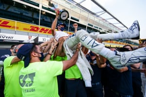 Pierre Gasly is hoisted in the air by his AlphaTauri colleagues.