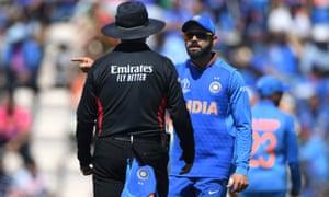 The India captain Virat Kohli speaks to umpire Richard Illingworth during the match against Afghanistan.