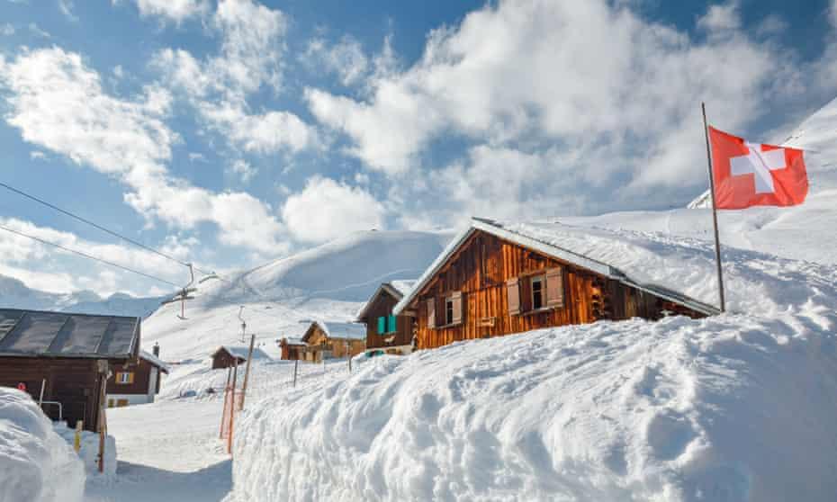Wooden huts covered by snow near Andermatt/Sedrun