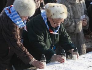 Holocaust survivors light candles