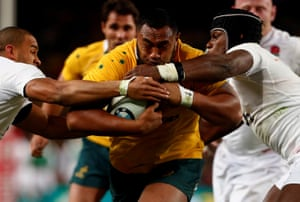 Australia's Sekope Kepu is tackled by England's Jonathan Joseph, left, and Maro Itoje.