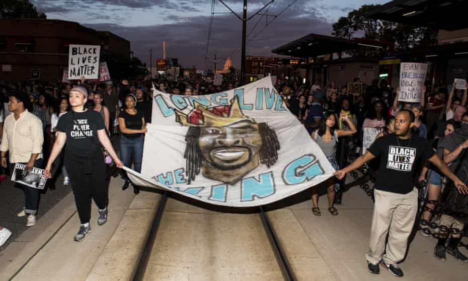 Protestors carry a banner depicting Philando Castile on in 2017 in neighboring St Paul, Minnesota.