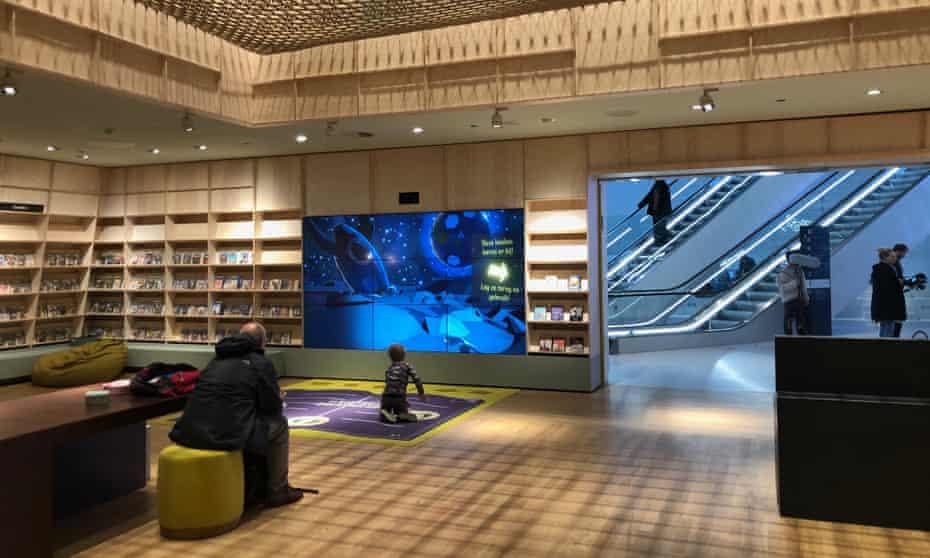 Joris Niekus plays an interactive game as his father watches him in the Forum complex in Groningen