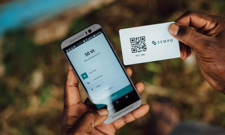 A ni-Vanuatu uses the Cash Unblocked app, part of a project that aims to directly provide cash assistance to those affected by natural disasters.