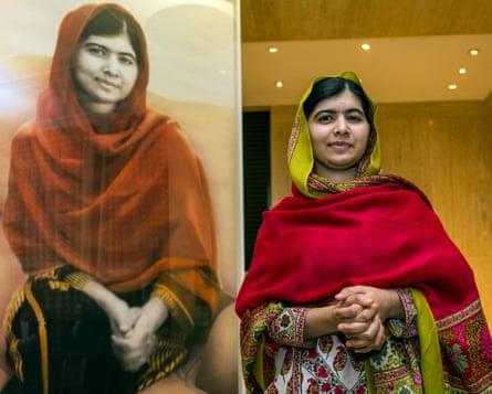 Malala Yousafzai with her portrait by Nasser Azam