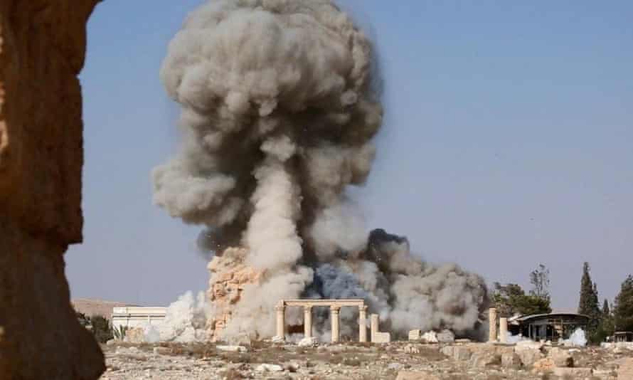 Cloud of dust after explosion among ruins, apparently at Palmyra