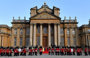 The two couples pause on the steps of the Great Court at Blenheim Palac