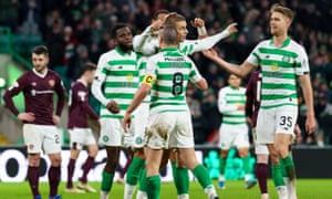 Celtic celebrate a goal against Hearts in February. If a vote passes to end the season Celtic will be champions and Hearts relegated.