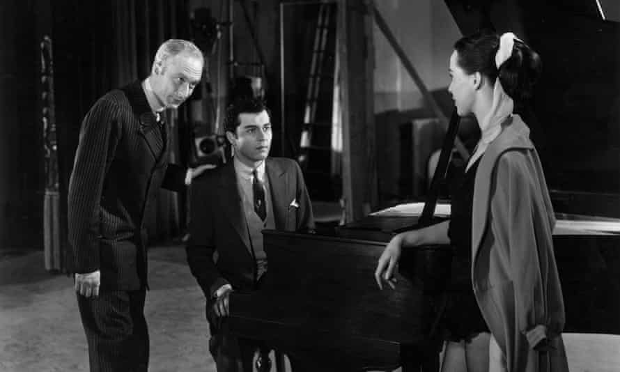 Norman Lloyd, Sydney Chaplin Jr (at the piano) and Clare Bloom in a scene from Charlie Chaplin's Limelight, 1952