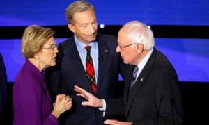 Elizabeth Warren speaks with Bernie Sanders as billionaire activist Tom Steyer listens after the seventh Democratic 2020 presidential debate at Drake University in Des Moines.