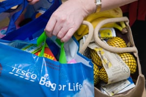 Woman carrying her shopping in reusable shopping 'bags for life'