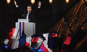 Emmanuel Macron waves to his supporters at the celebration of his election victory at the Louvre, Paris.