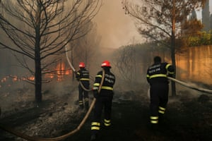 Firefighters try to extinguish a wildfire in the village of Mravince near Split, Croatia